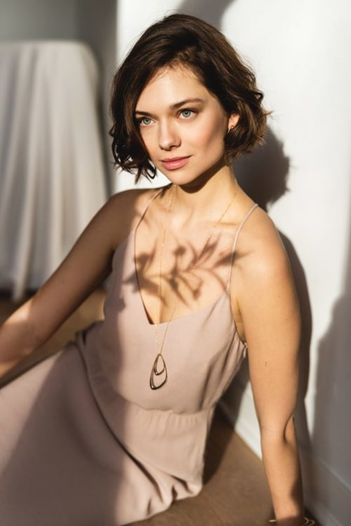 Gold sustainable ethical conscious bridal dancing waves necklace on model