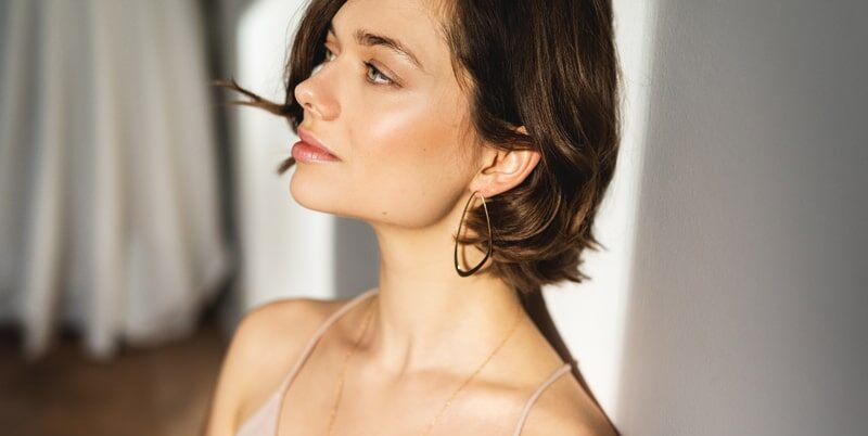 Gold sustainable ethical conscious bridal ebb tide earrings on model