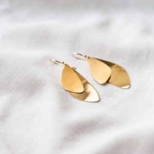 Gold sustainable ethical conscious bridal majestic mussel earrings styling image