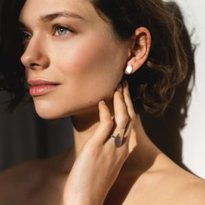 Silver sustainable ethical conscious bridal dainty pebble stud earrings mat on model