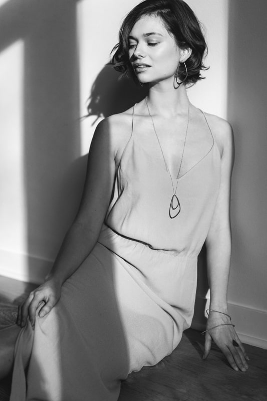 Silver sustainable ethical conscious bridal dancing waves necklace on model