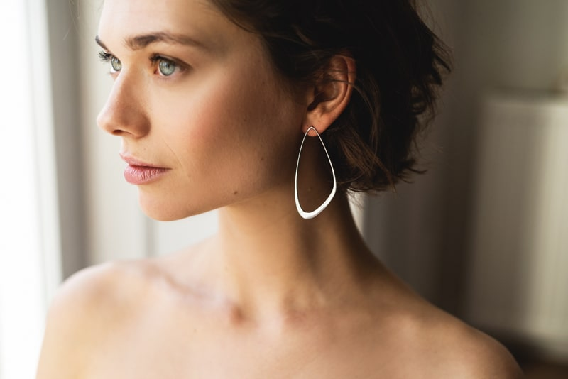 Silver sustainable ethical conscious bridal ebb tide earrings on model