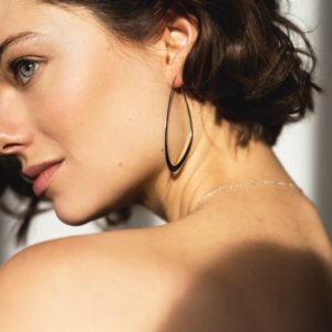 Silver sustainable ethical conscious bridal flow tide earrings on model