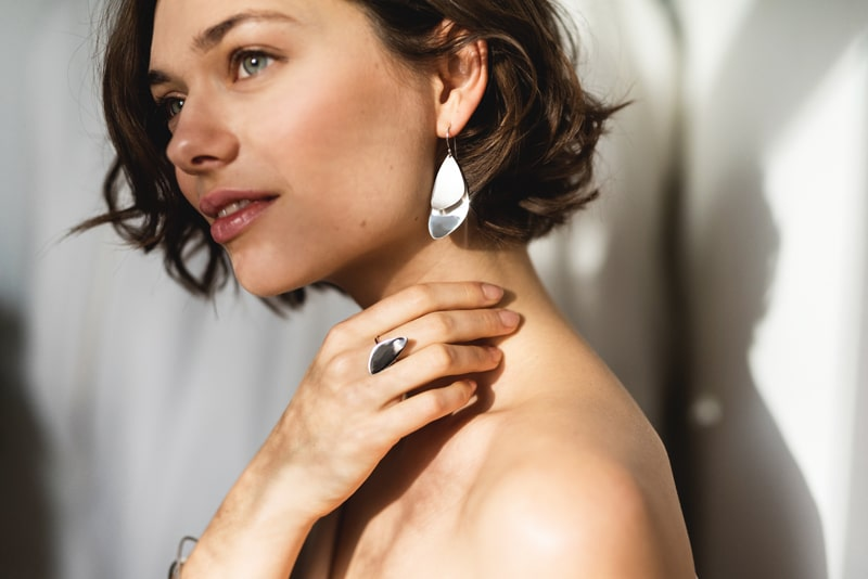 Silver sustainable ethical conscious bridal majestic mussel earrings on model